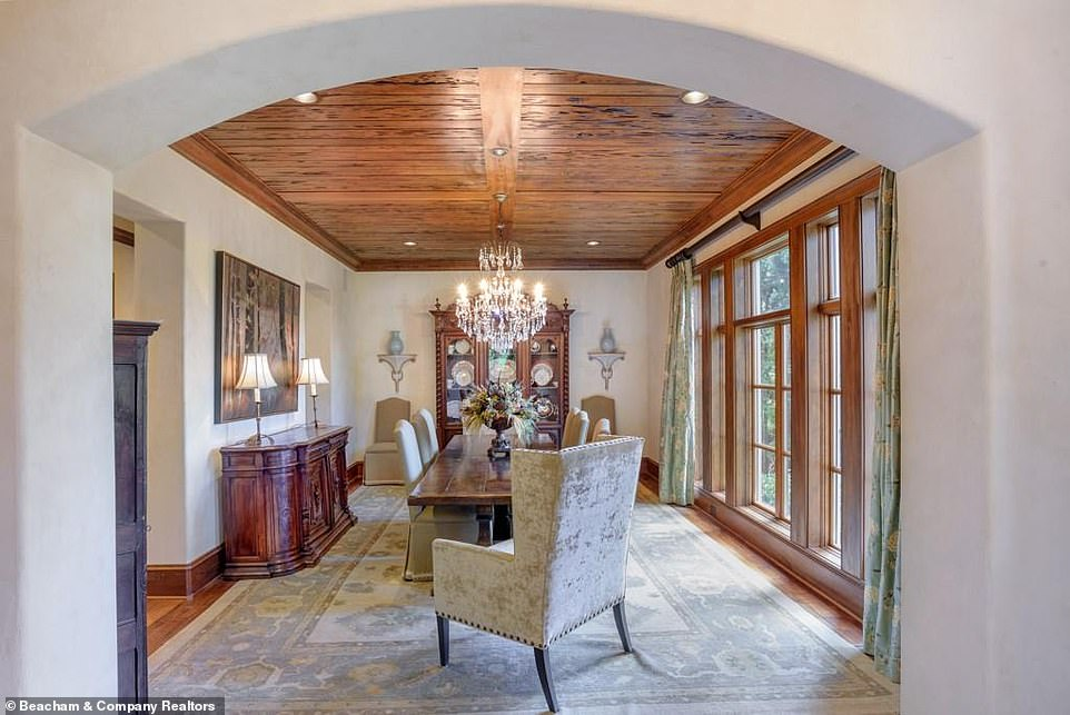 Time to chow down:Another dining room has one long casement window spanning the entirety of one of the walls, so that diners can look out at the expansive estate outside