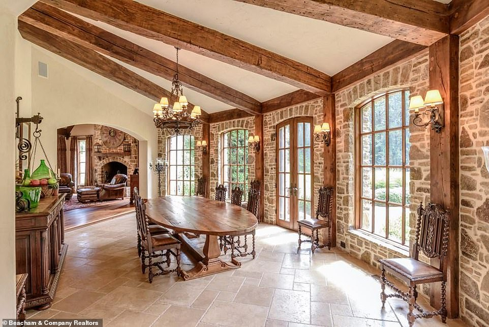 So many options:There are also multiple dining rooms in the house, including one with a row of vaulted casement windows allowing light to stream in from the grounds