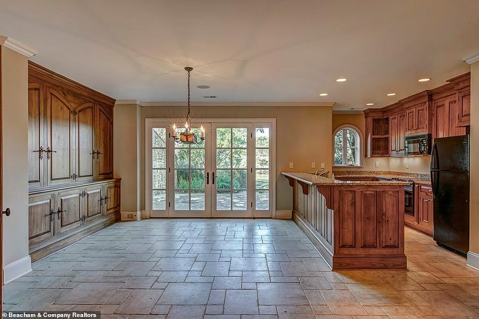 In touch with nature:There is a small kitchen on the estate with a wood-paned glass door leading directly outside, as well as a small chandelier and plenty of room for a dining table nearby