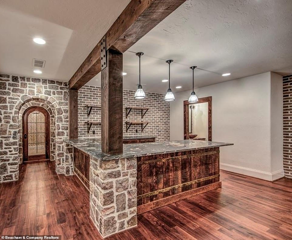 Looking amazing:Another kitchen includes stone accents similar to the exterior of the main house, including around the vaulted entryway and on one of the pillars under the counter