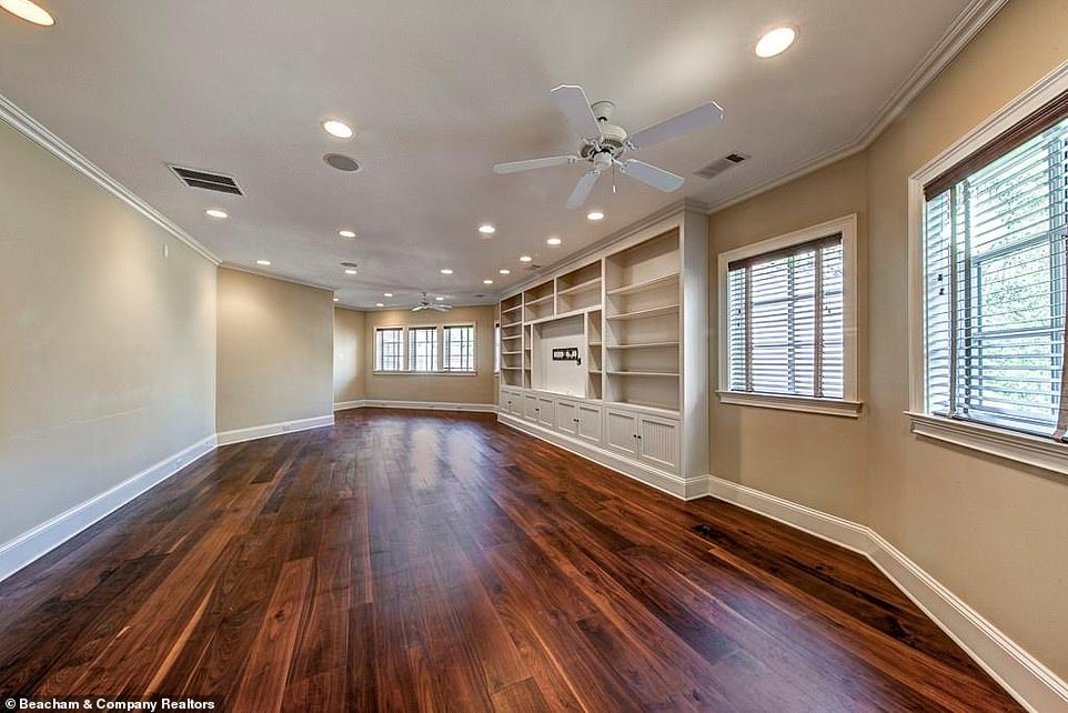 Great:One spacious room has white shelving constructed into one of the walls, with room for a television set and a ceiling fan for the warmer months