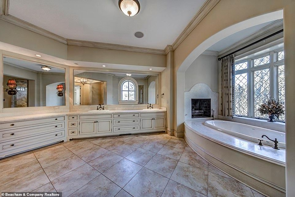 Beautiful:In fact one of the larger bathrooms includes two fully separate counters with their own mirrors, placed opposite a bathtub that comes with not just a curtained window but also a fireplace