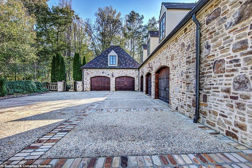 Holy cow:The property is certainly fit for entertaining guests as there is a five-car garage situated along one side of the house adjacent to a vast driveway