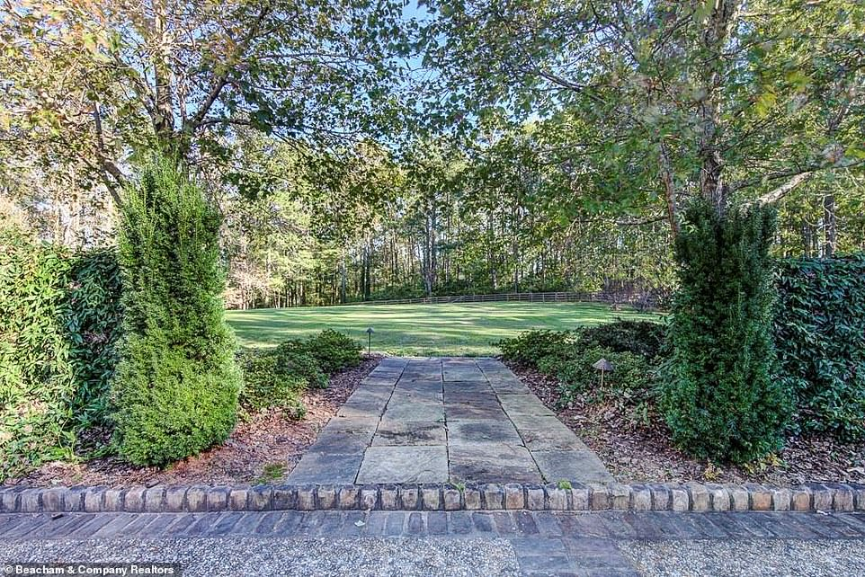 Legging it:Trees line the stone path leading up to the house