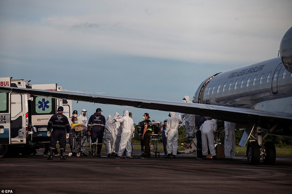Health workers transfer COVID-19 patients that are to be treated in other cities in Manaus, Brazil