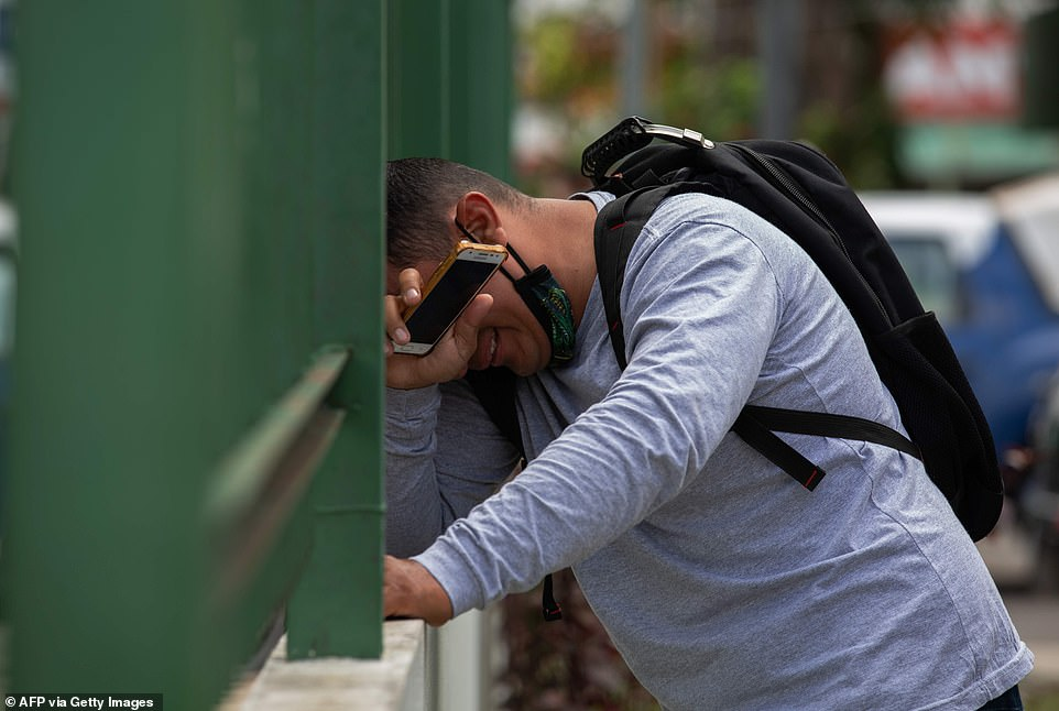 A man breaks down outside the 28 de Agosto hospital as Manaus faces a shortage of bed space and oxygen supplies