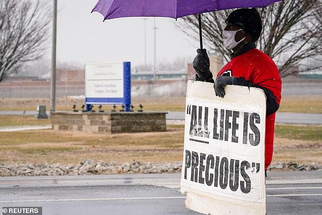An activist in opposition to the death penalty protests during a snowstorm outside of the United States Penitentiary in Terre Haute, Indiana on Thursday ahead of Higgs' execution
