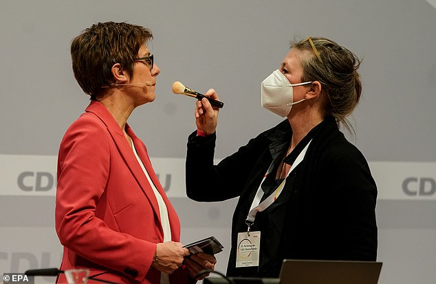 Christian Democratic Union (CDU) party leader Annegret Kramp-Karrenbauer gets a final touch of make-up before going out to speak to the party conference in Berlin