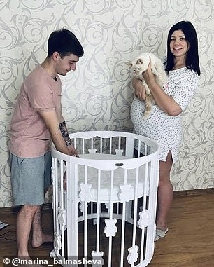 Marina pictured preparing the nursery with her 21-year-old husband