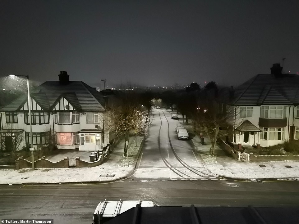 Drivers on the roads in the early hours warned of treacherous conditions on the M40 towards London. One Twitter user wrote: 'Horrendous journey into London. Crashed car across carriageway north of Cherwell Services on M40. (Called police). Further south, carriageway surface dangerous with falling snow.' Pictured, a snow-covered London street