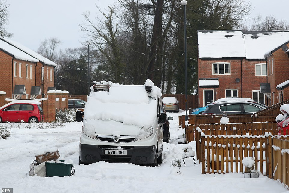A snow covered street in Catterick, North Yorkshire. Parts of eastern England could see up to four inches of snow on Saturday as forecasters warned of the potential for 'significant disruption'