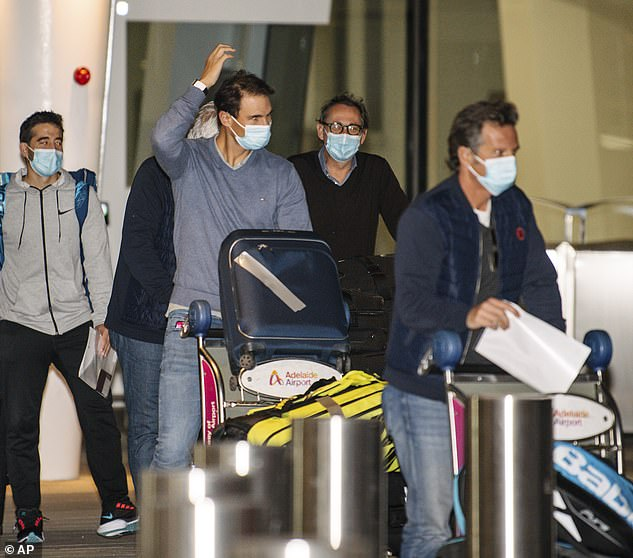 Spanish starRafael Nadal (pictured centre) has also touched down in Australia