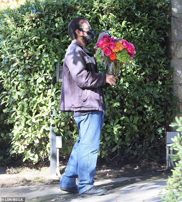 Presents:Multiple bouquets and packages were seen being dropped off at the entertainer's home on Sunday, and her agent accepted many of the gifts outside her home's gate