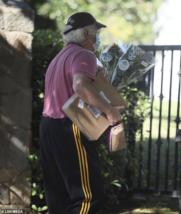 Old pals: The Golden Girls star's agent Jeff Witjas was spotted arriving with multiple bouquets, a package and a McDonald's bag for his client