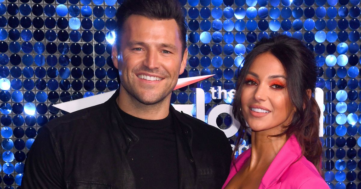 Michelle Keegan and dogs join Mark Wright as she sits on radio studio floor