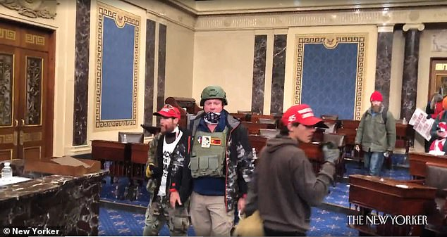 The men are seen wearing MAGA hats, bulletproof vests and other gear as they stormed the Capitol