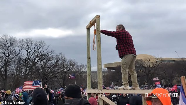 Another portion of the clip shows a man erecting gallows outside the Capitol building on January 6