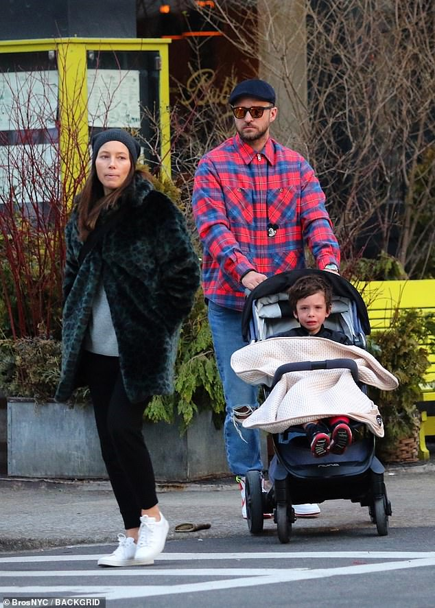 The couple - who have been dating since 2007 - are pictured out in New York with son Silas in February. Biel would have been around three months pregnant at the time