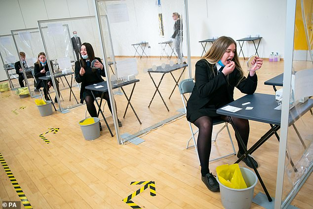 Students takes a COVID-19 test at Oasis Academy in Coulsdon, Surrey