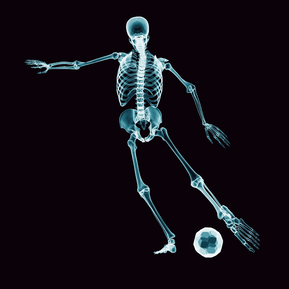 Drawing of a skeleton playing soccer