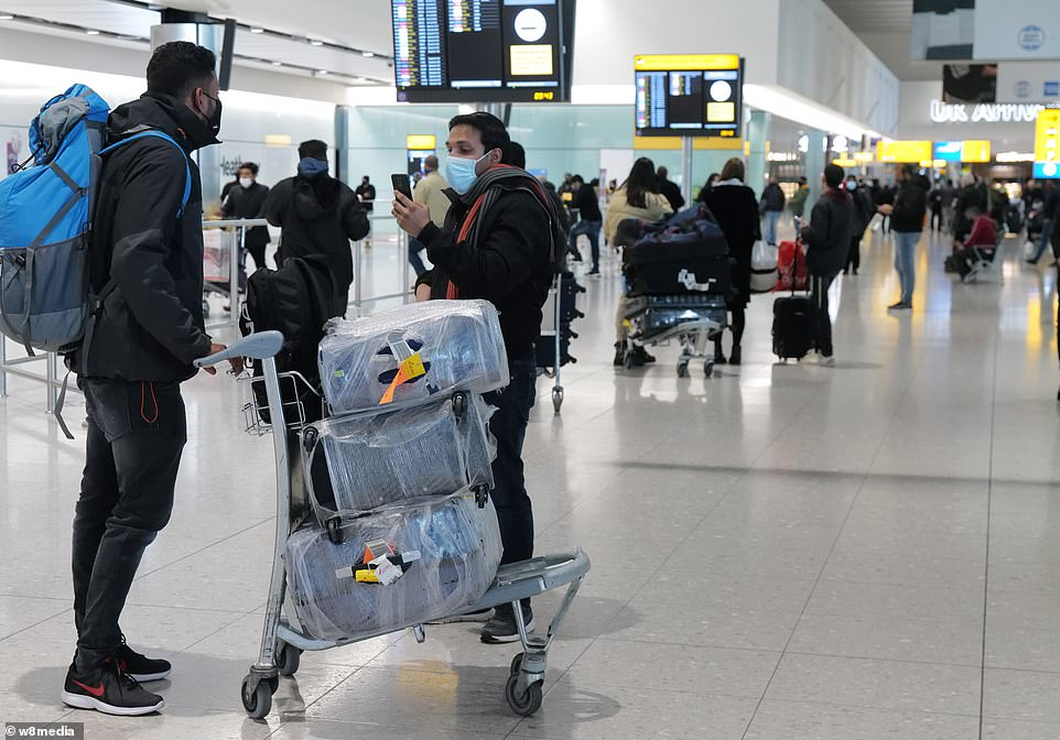 Passengers arrive at London Heathrow Airport this morning one day after the new rules on Covid-19 tests were brought in