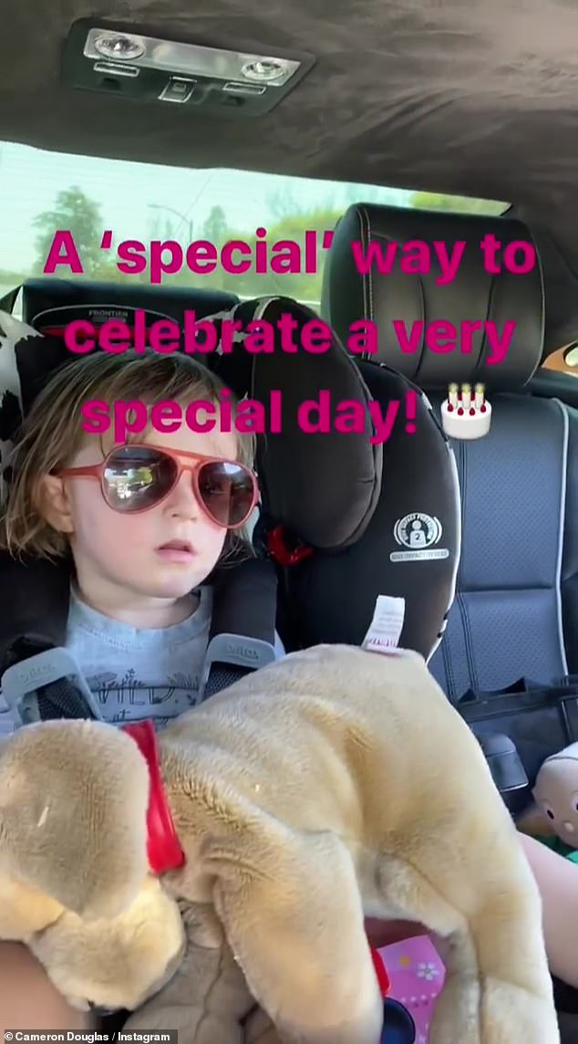 Cute: Daughter Lua was also in the car holding on to her stuffed animal