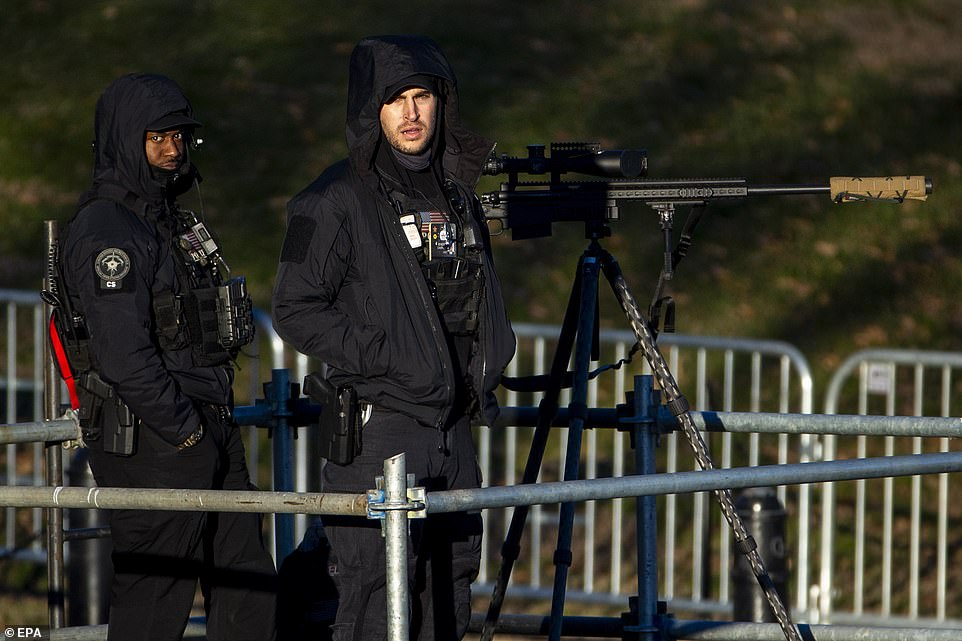 US Secret Service special operations personnel stand post in the hours leading up to the event. The personnel are seen in the above image standing next to a sniper rifle