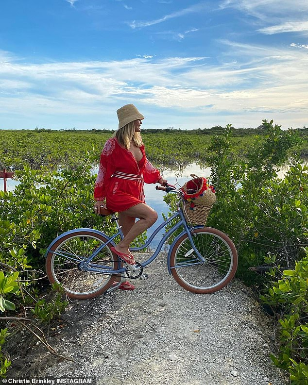 A pinup still:And earlier Christie was seen in all red as she rode her bicycle by the shore