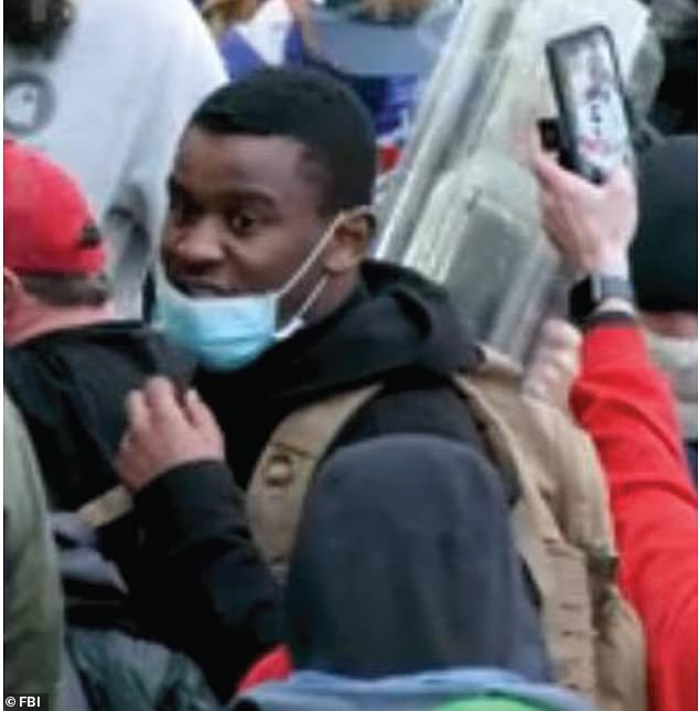 Federal authorities said that Emanuel Jackson (pictured) turned himself in to police in Washington, DC. Jackson is alleged to have assaulted officers with a metal baseball bat