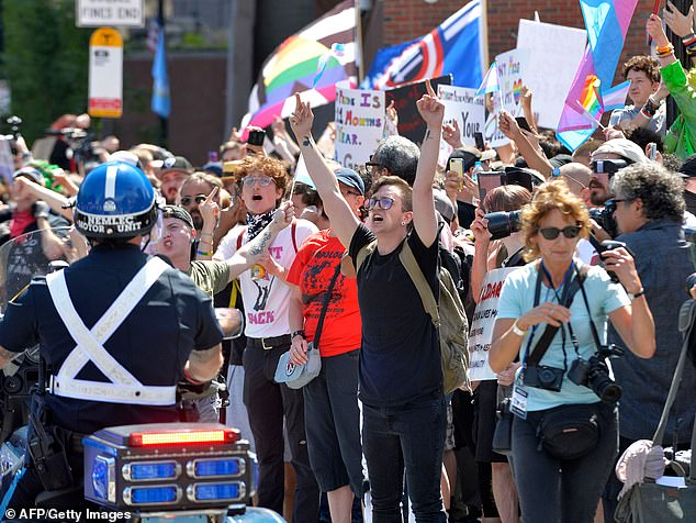 Sahady is the vice president of Super Happy Fun America, the 'straight pride' group that organized a controversial parade in Boston in August 2019. Counter-protesters scream at police as they escort the 'Straight Pride' participants