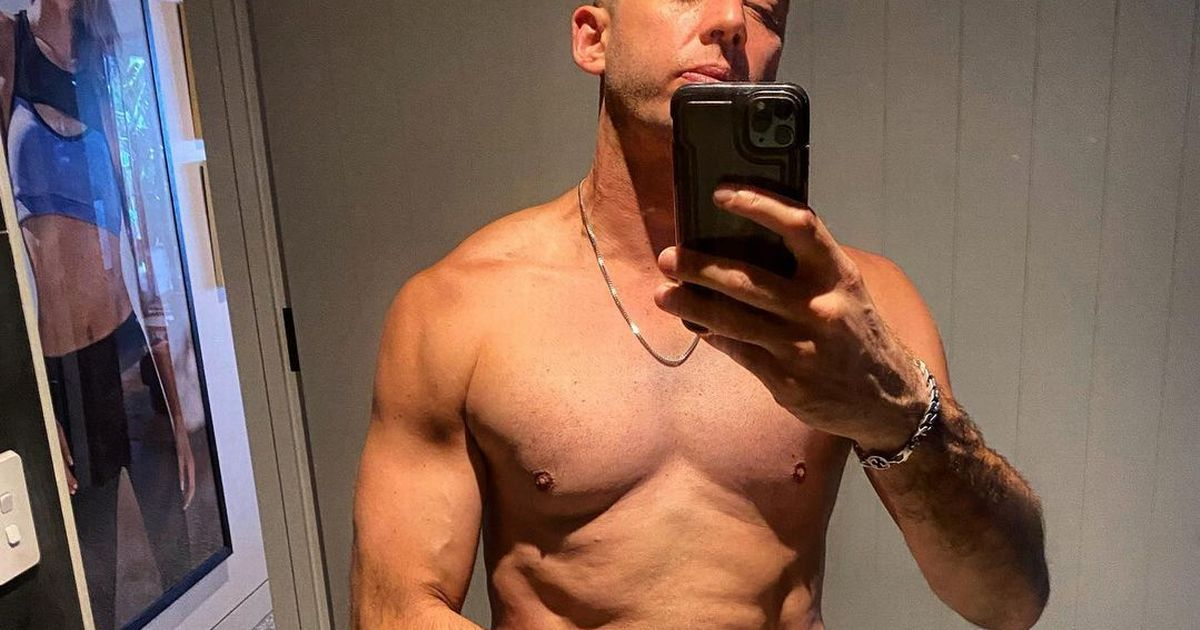 Example transforms dad bod into rippling muscled torso as he enjoys life in Aus