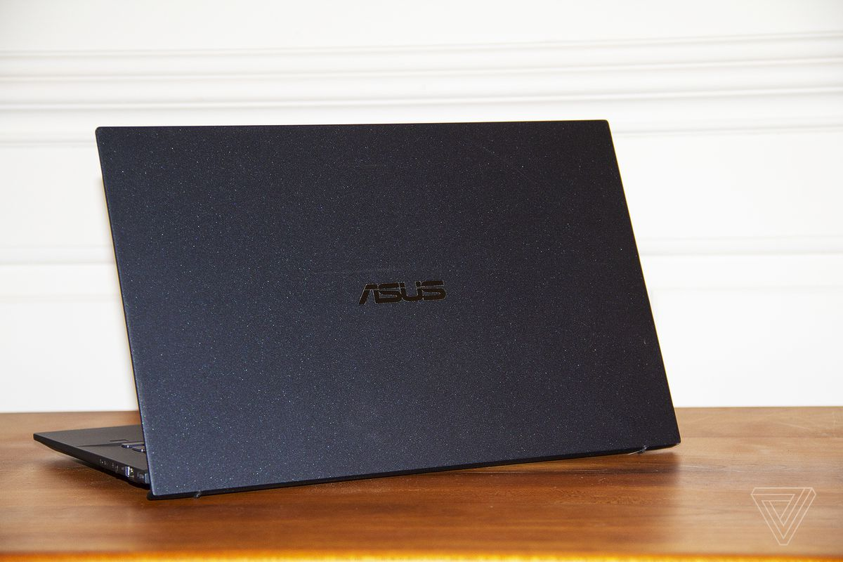 The Asus ExpertBook B9450 facing away from the canera, angled to the left.