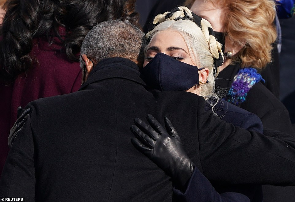 Fan club: The star was seen in an emotional embrace with President Barack Obama following her song