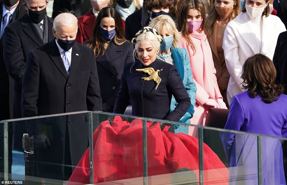Her emotional performance came moments before Harris was sworn in by Justice Sonia Sotomayor - the first Latina Supreme Court Justice. Pictured Gaga with Biden, Harris and their families