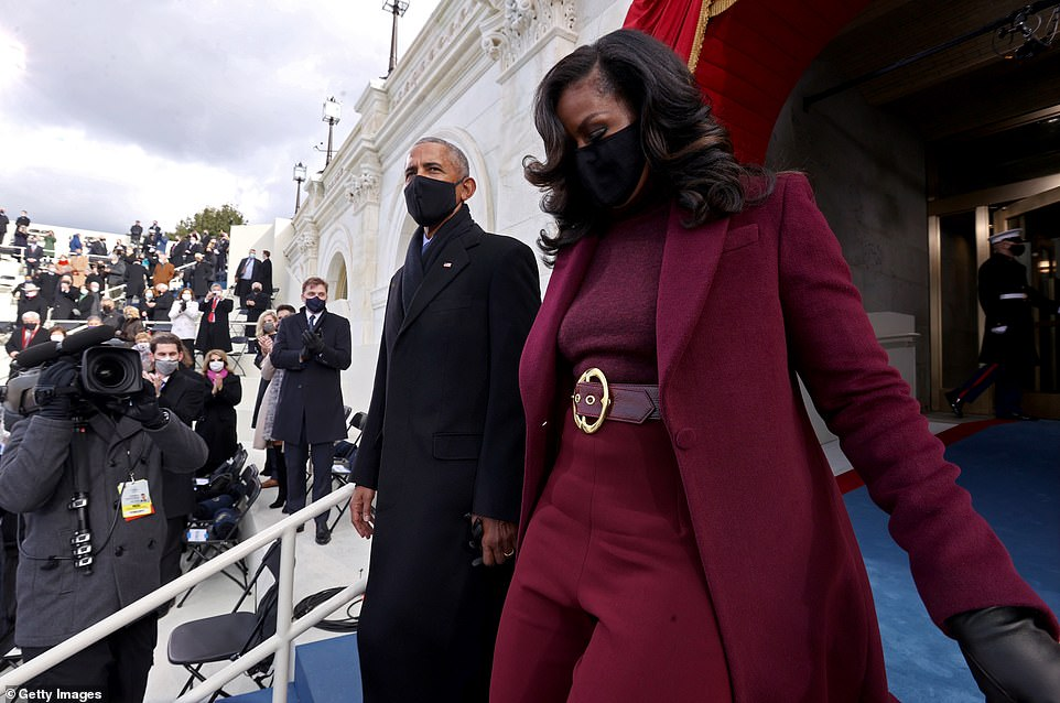 The Obamas walk down the Capitol steps before Biden and Harris arrive to take their oaths