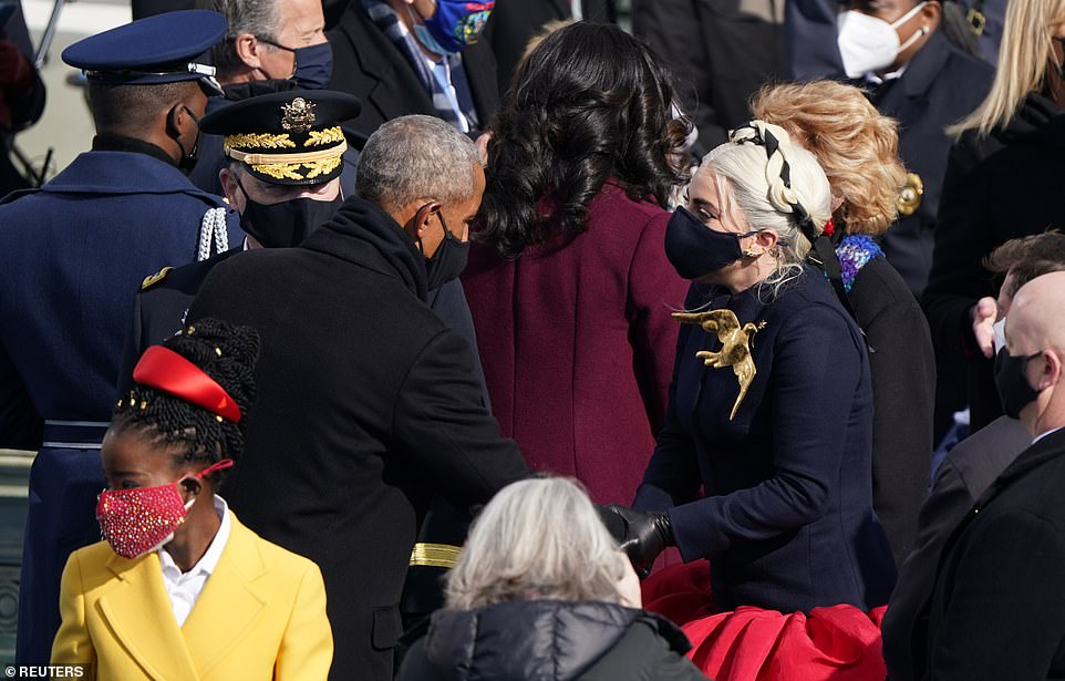 Barack Obama and Lady Gaga talk after Joe Biden and Kamala Harris were swore in to lead the country