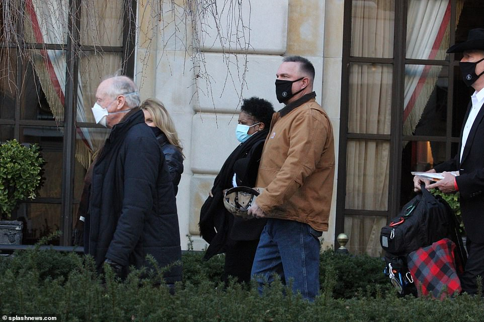 Country music star Garth Brooks was seen heading from his nearby hotel to the inauguration after he confirmed Monday that he will be joining the star line-up