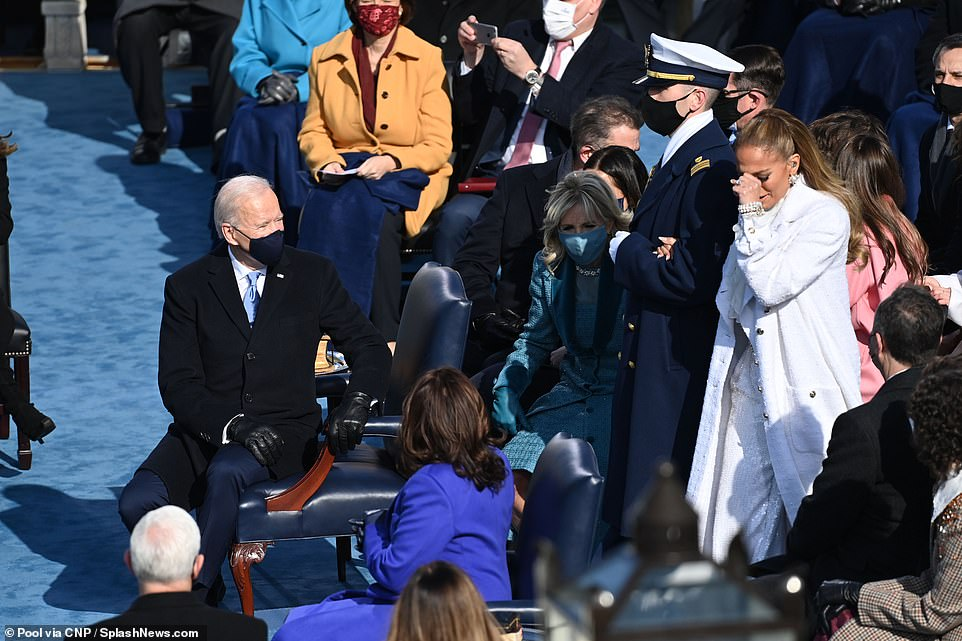 Joe and Jill Biden and Kamala Harris watch and smile as J-Lo walks to the stage to perform at the inauguration