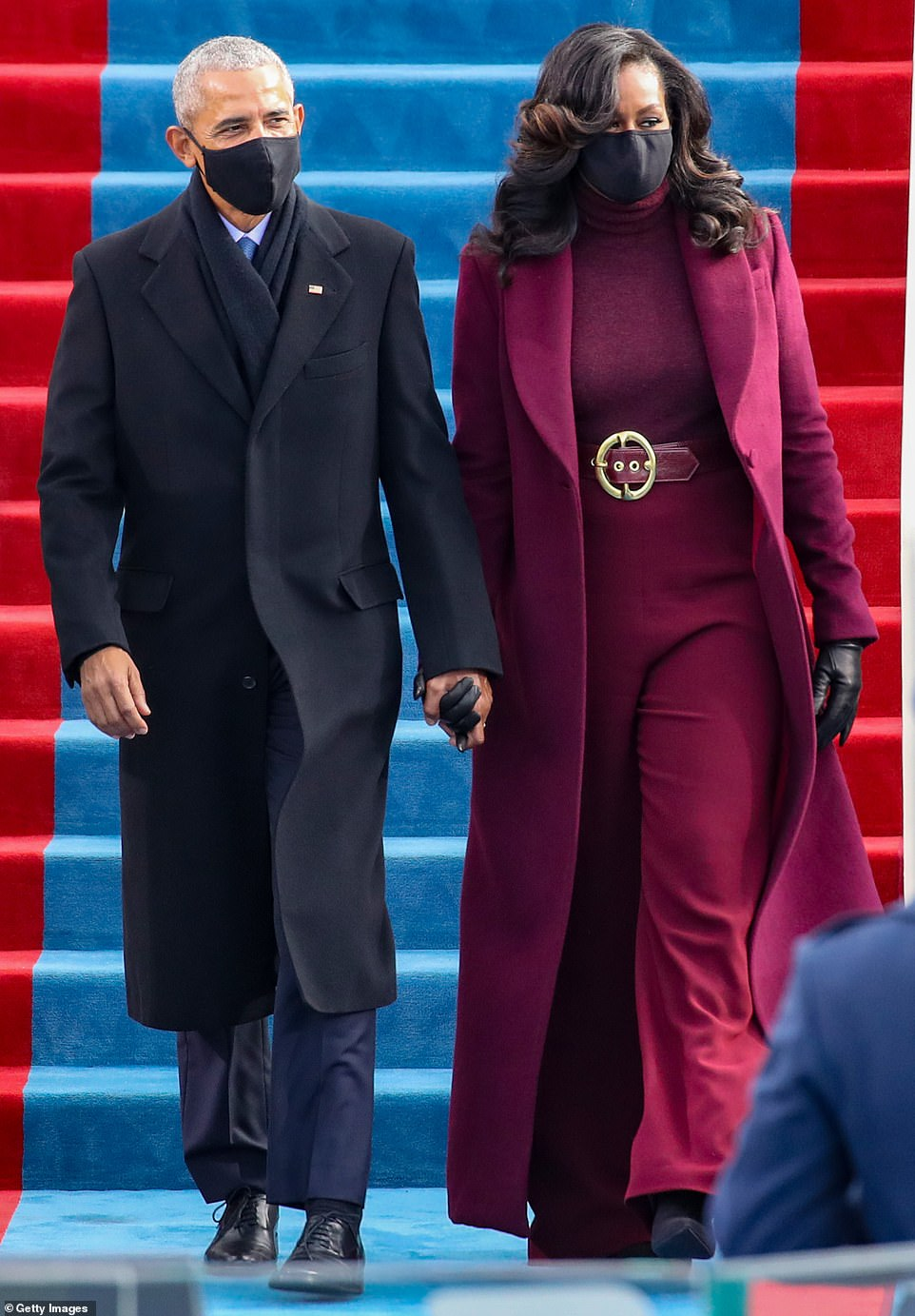 Icon: Taking a cute from Harris, Mrs. Obama cut a stylish figure in head-to-toe plum at the inauguration