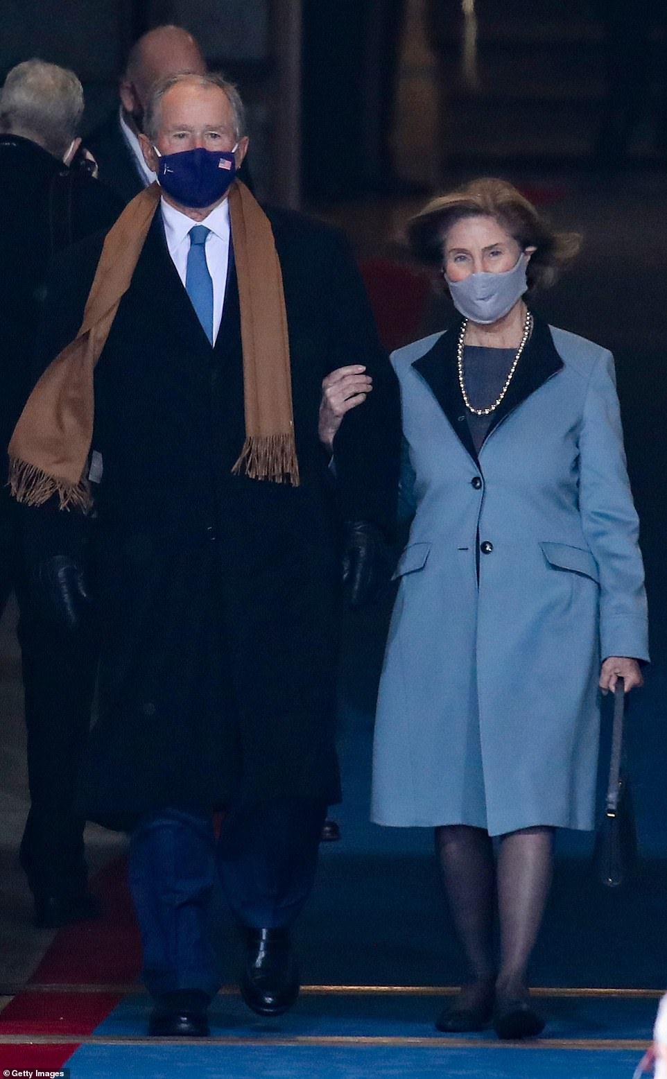 Arm-in-arm: Mrs. Bush arrived at the U.S. Capitol with her husband, former President George W. Bush