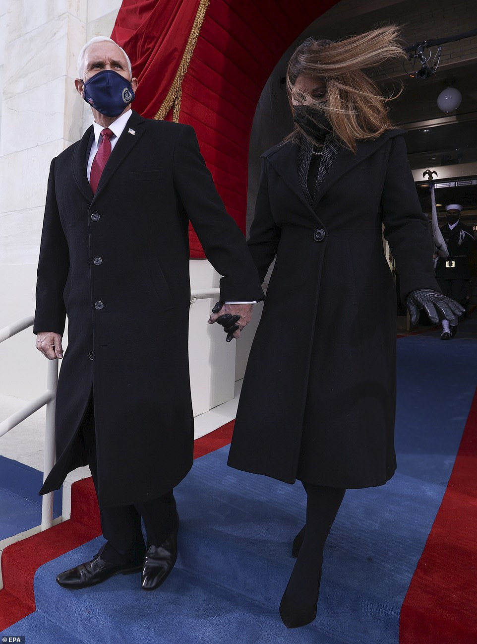 Breezy: Mrs. Pence's hair whipped in the wind as she arrived at the inauguration with her husband