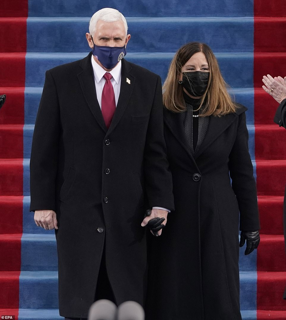 United front: The couple held hands as they walked down the stairs together