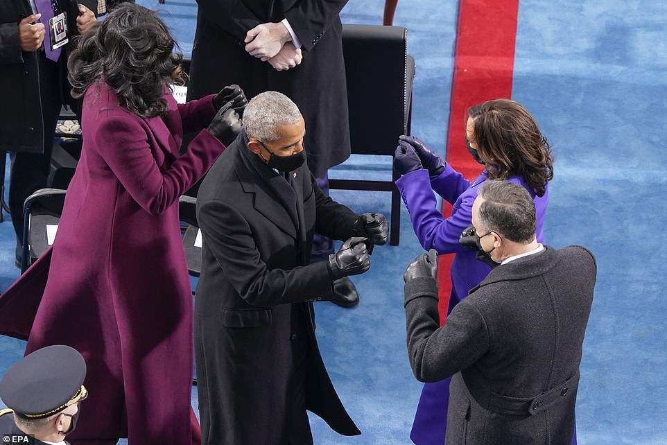 Joyous occasion: The Obamas fist-bumped Harris and her husband when they walked by