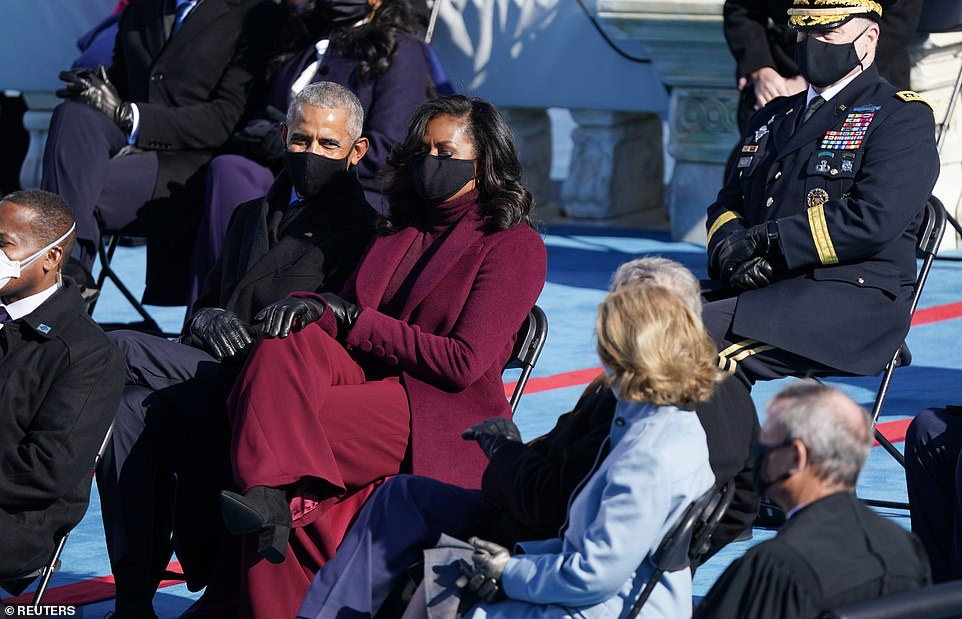 Socially distanced: The seats were spaced apart with the Obamas right next to the Bushes