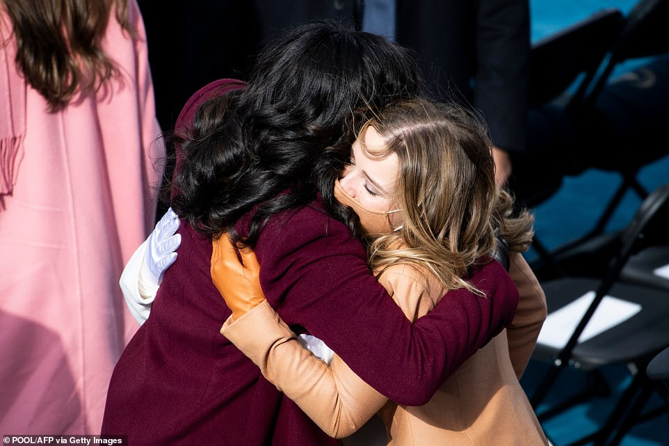 Saying hi: Mrs. Obama gave Biden's granddaughter Finnegan Biden a warm hug