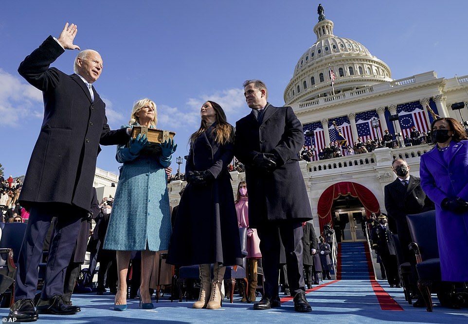 New era: Biden raised his hand and took an oath to 'preserve, protect, and defend' the Constitution on Wednesday — starting his tenure amid a pandemic and putting an end to a tumultuous four-year term by President Trump