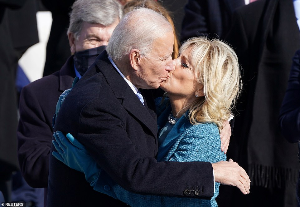 Sweet moment: The Bidens shared a kiss after he was sworn in as the 46th President of the United States on the West Front of the U.S. Capitol