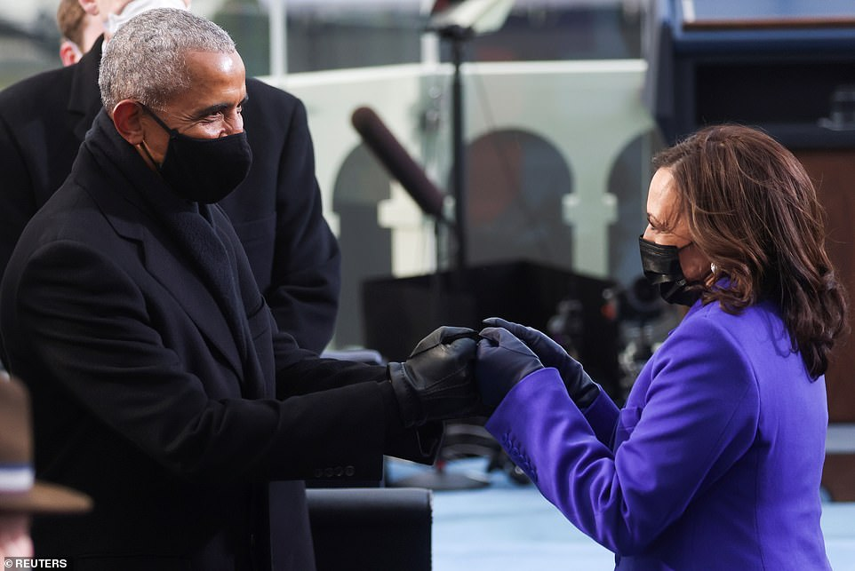 Vice President-elect Kamala Harris greets former U.S. President Barack Obama ahead of the inauguration of Joe Biden