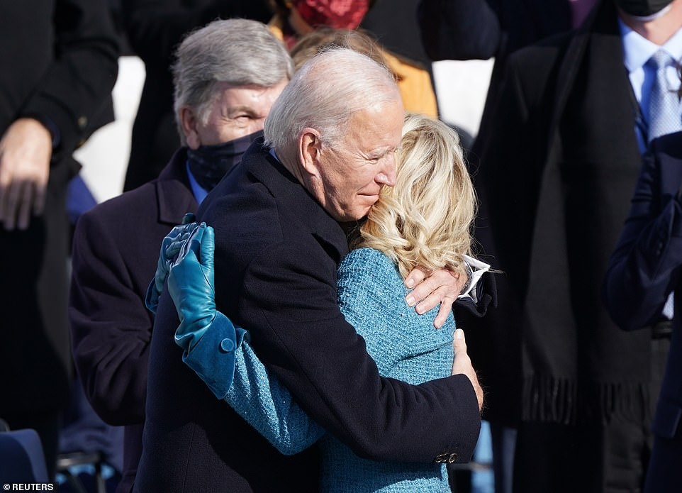 Joe Biden hugs his wife Jill Biden after he was sworn in as the 46th President of the United States