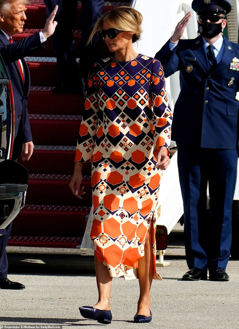 Changes: Melania changed her outfit on the plane from Washington, D.C., swapping a somber black ensemble for a colorful $3,700 Gucci dress and navy ballerina flats